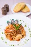 Spaghetti seafood with garlic bread Royalty Free Stock Image
