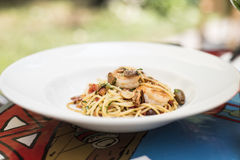 Spaghetti with seafood and kalamata olives. Dish at the restaurant Royalty Free Stock Photography