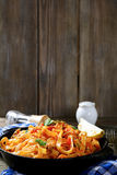 Spaghetti with seafood in a pan on the boards Stock Photo