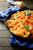 Spaghetti with seafood and sauce in a pan Royalty Free Stock Photos