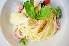 Spaghetti with seafood and tomatoes stock photo