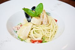 Spaghetti with seafood and tomatoes royalty free stock photo