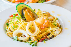 Spaghetti. Seafood in white dish on the stone table Royalty Free Stock Image