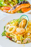 Spaghetti. Seafood in white dish on the stone table Stock Photos