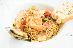 Spaghetti seafood in white plate. Spicy Spaghetti seafood in white plate Stock Photo