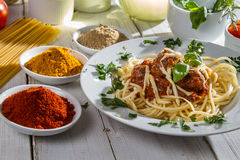 Spaghetti served with fresh vegetables Stock Photos