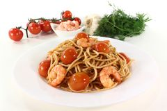 Spaghetti with shrimp and dill Stock Photos