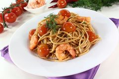 Spaghetti with shrimp and dill Stock Photography