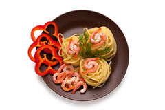Spaghetti with shrimp and red pepper. Spaghetti with shrimp and pepper in a clay dish Stock Photo