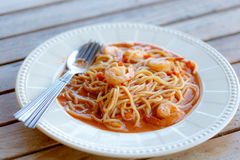 Spaghetti shrimp in white dish on table Royalty Free Stock Image
