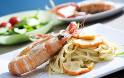 Spaghetti with shrimps. Delicious spaghetti with shrimps and fresh herbs and lobster Stock Photo