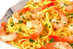 Spaghetti with shrimps. Delicious spaghetti with shrimps and fresh herbs stock photos