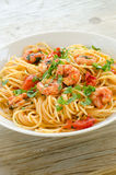 Spaghetti with shrimps and parsley Stock Photo