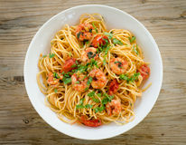 Spaghetti with shrimps and parsley Royalty Free Stock Photos