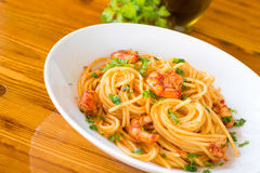 Spaghetti with shrimps and tomato sauce Stock Images