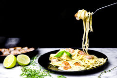 Spaghetti with shrimps twirled on fork Royalty Free Stock Images