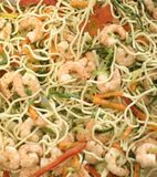 Spaghetti with shrimps and vegetables for a supper Stock Photos