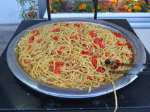 Spaghetti with slices of red pepper Stock Photos