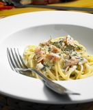 Spaghetti with smoked salmon Stock Photos
