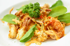 Spaghetti soft shell crab. In white dish Royalty Free Stock Image