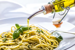 Spaghetti. Spaghetti with homemade pesto sauce olive oil and basil leaves.  Royalty Free Stock Photo