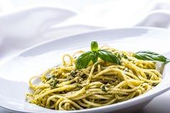 Spaghetti. Spaghetti with homemade pesto sauce olive oil and basil leaves.  Stock Image