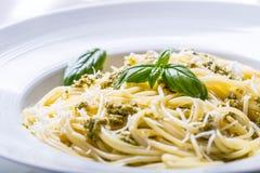 Spaghetti. Spaghetti with homemade pesto sauce olive oil and basil leaves.  Stock Photo