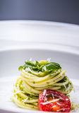 Spaghetti. Spaghetti with homemade pesto sauce olive oil and basil leaves.  Royalty Free Stock Images