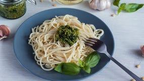 Spaghetti. Spaghetti with homemade pesto sauce olive oil and basil leaves. Spaghetti. Spaghetti with homemade pesto sauce olive oil and basil leaves Stock Image