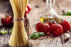 Spaghetti.Spaghetti tomatoes basil olive oil parmesan cheese and mushrooms on very old oak board. Royalty Free Stock Images