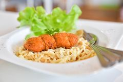 Spaghetti with spicy fried chicken Stock Image