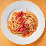 Spaghetti with spicy tomato sauce Stock Photos