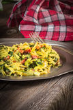 Spaghetti with spinach and bacon. Stock Photo