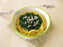 Spaghetti with spinach Stock Photos