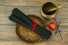 Spaghetti with squid ink on wooden background Stock Images