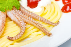 Spaghetti with squid and parsley Stock Photos