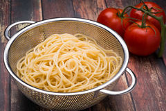 Spaghetti in a stainless steel collander Royalty Free Stock Images