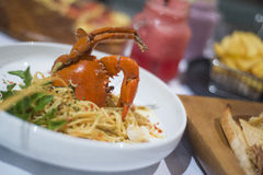 Spaghetti with steamed crab and spicy sauce Stock Image