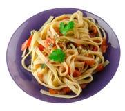 Spaghetti su un piatto Fotografia Stock Libera da Diritti