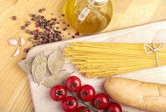 Spaghetti on table. Ingredients for cooking italian pasta Stock Photography