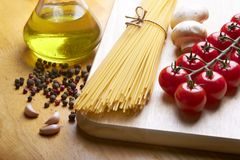 Spaghetti on table. Ingredients for cooking italian pasta Royalty Free Stock Photos