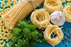 Spaghetti and tagliatelle with ingredients Stock Image