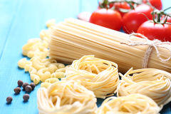 Spaghetti and tagliatelle with ingredients Stock Photography