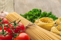 Spaghetti and tagliatelle with ingredients Royalty Free Stock Image