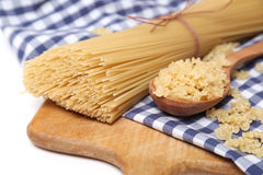 Spaghetti on textile Stock Images