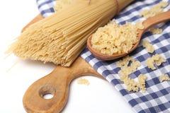 Spaghetti on textile Stock Photos