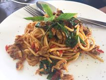 Spaghetti with Thai style sauce. With clam. Spicy fusion food in the restaurant royalty free stock image