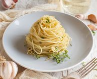 Spaghetti with thyme, garlic and olive oil. Close up royalty free stock image