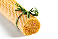 Spaghetti tied with green ribbon Stock Image