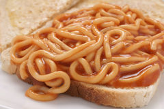 Spaghetti on toast Stock Images
